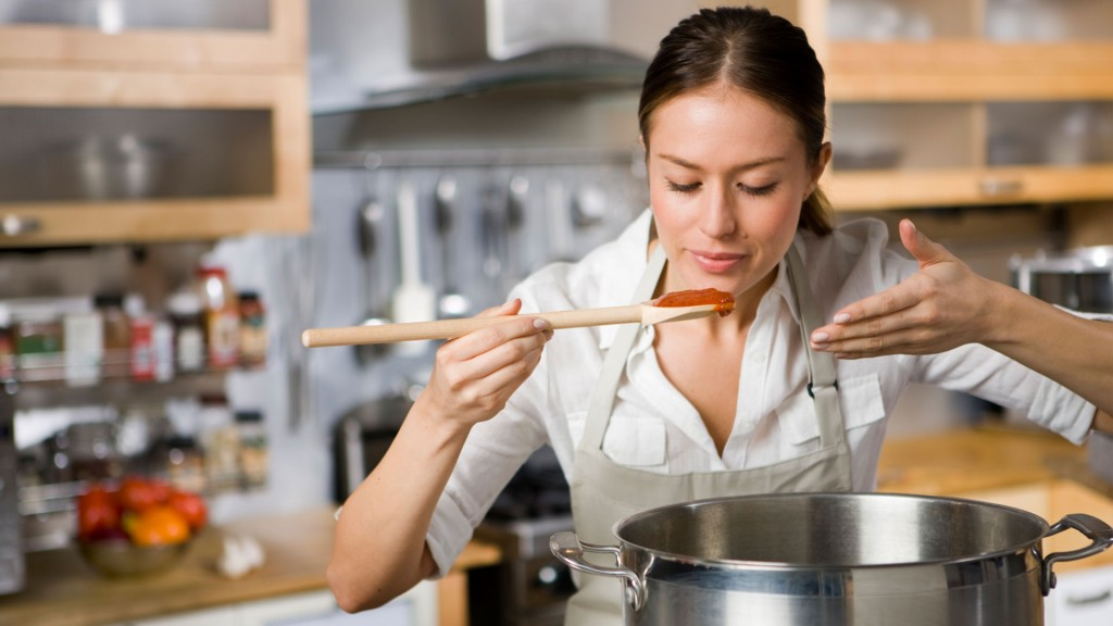 Woman-cooking-pasta-sauce