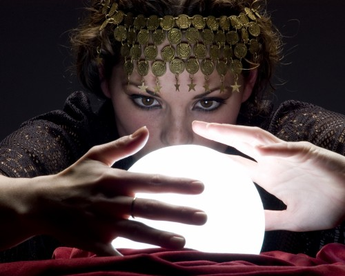 fortune teller with glowing crystal ball